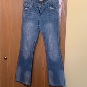 Blue jeans with design on pockets